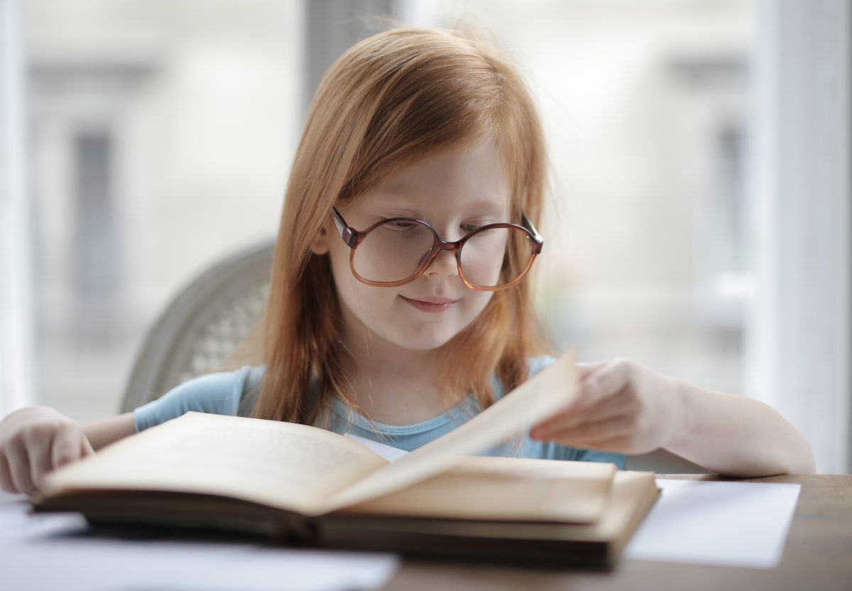 girl-reading-a-book-with-eyeglasses-3887454-1200x832.jpg